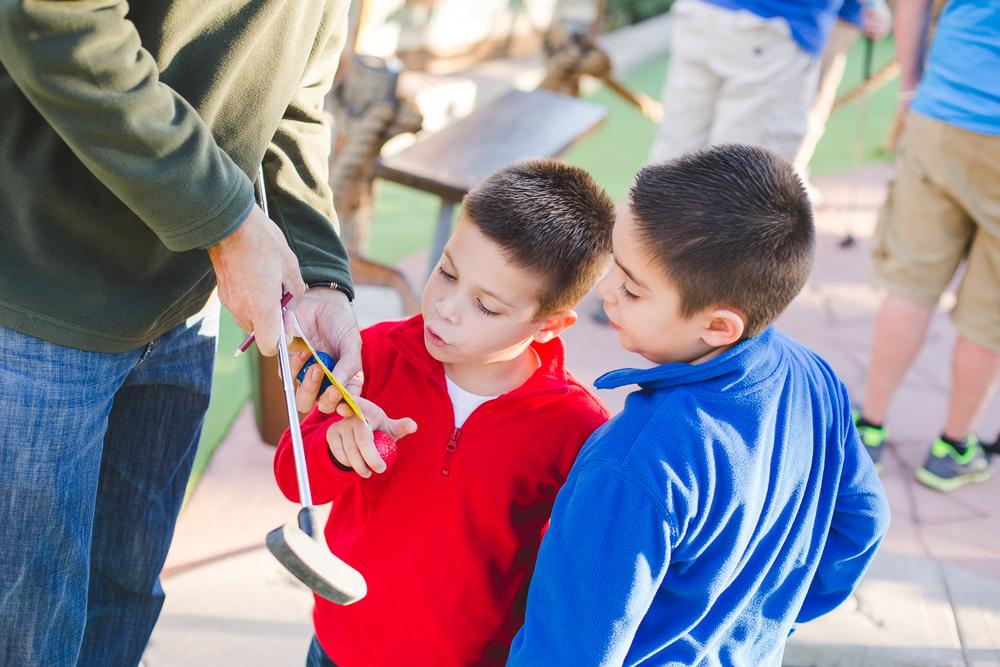 the boys learn how to keep score mini golf