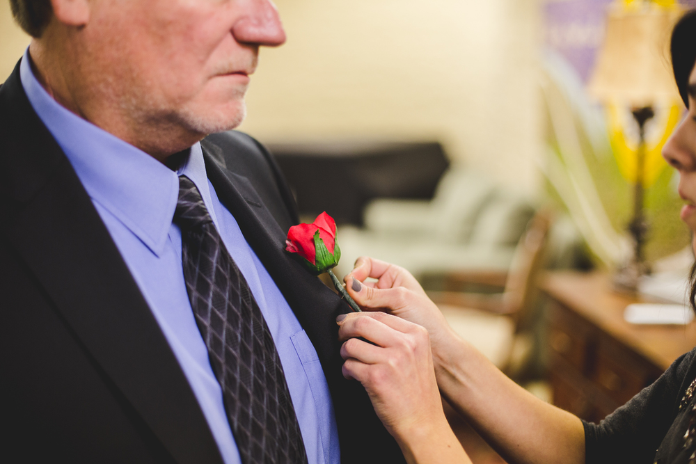 rs uncle puts boutonnière on