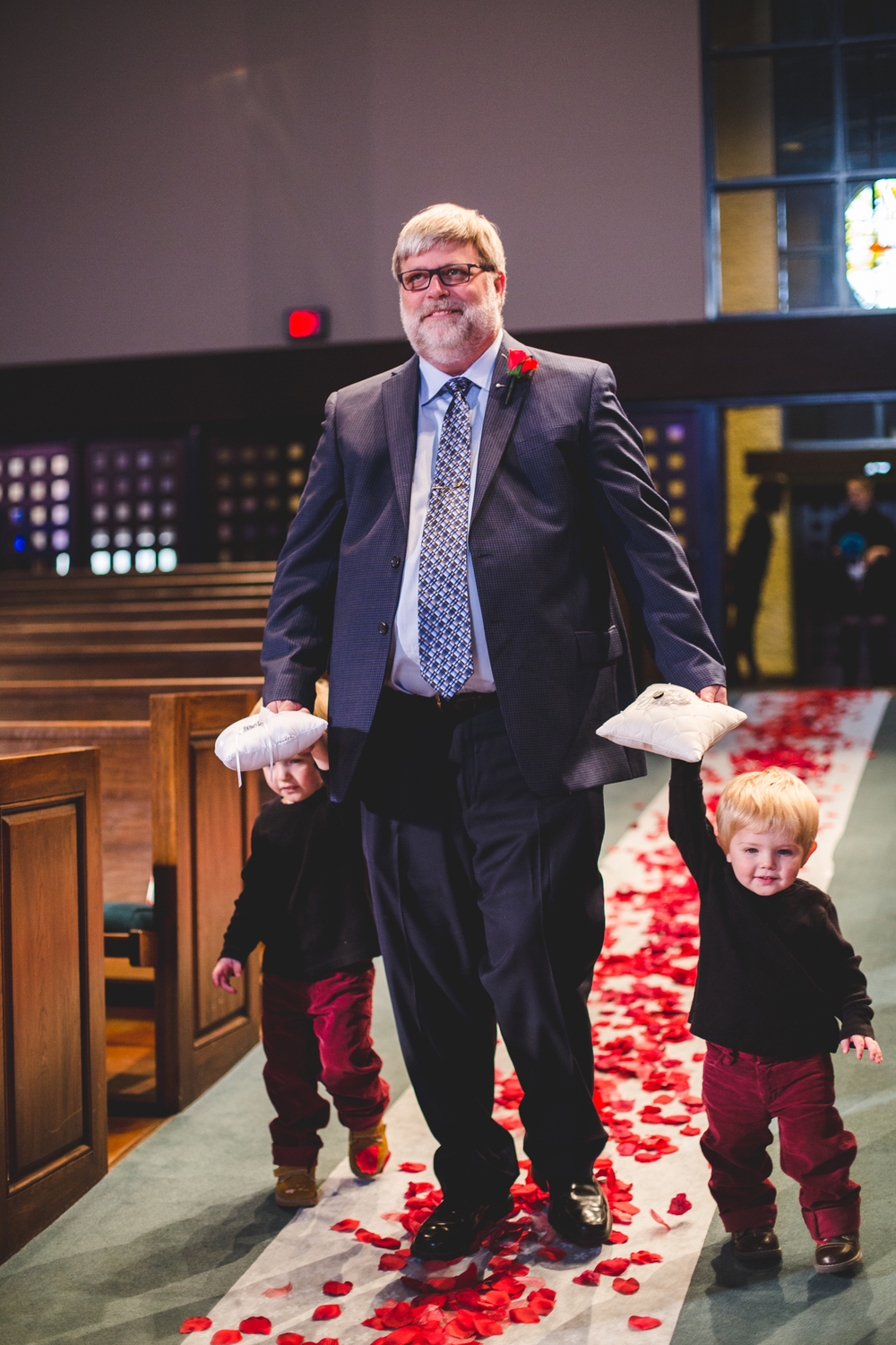 rs ring bearers come down aisle