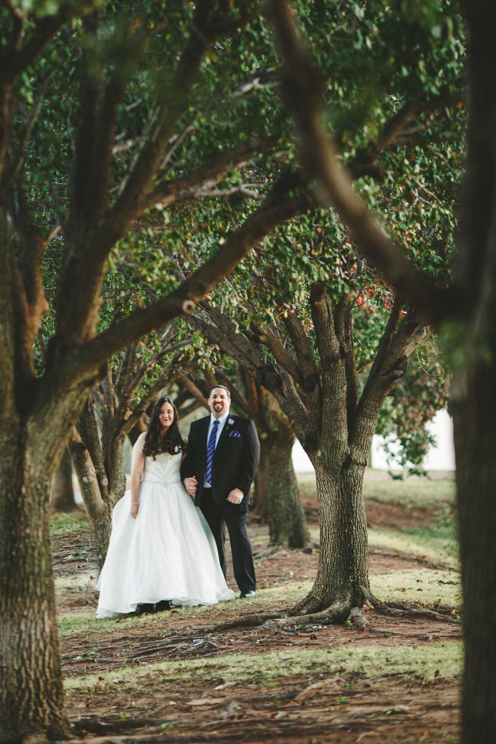 rs bride groom creative portrait among tress greenery oklahoma city
