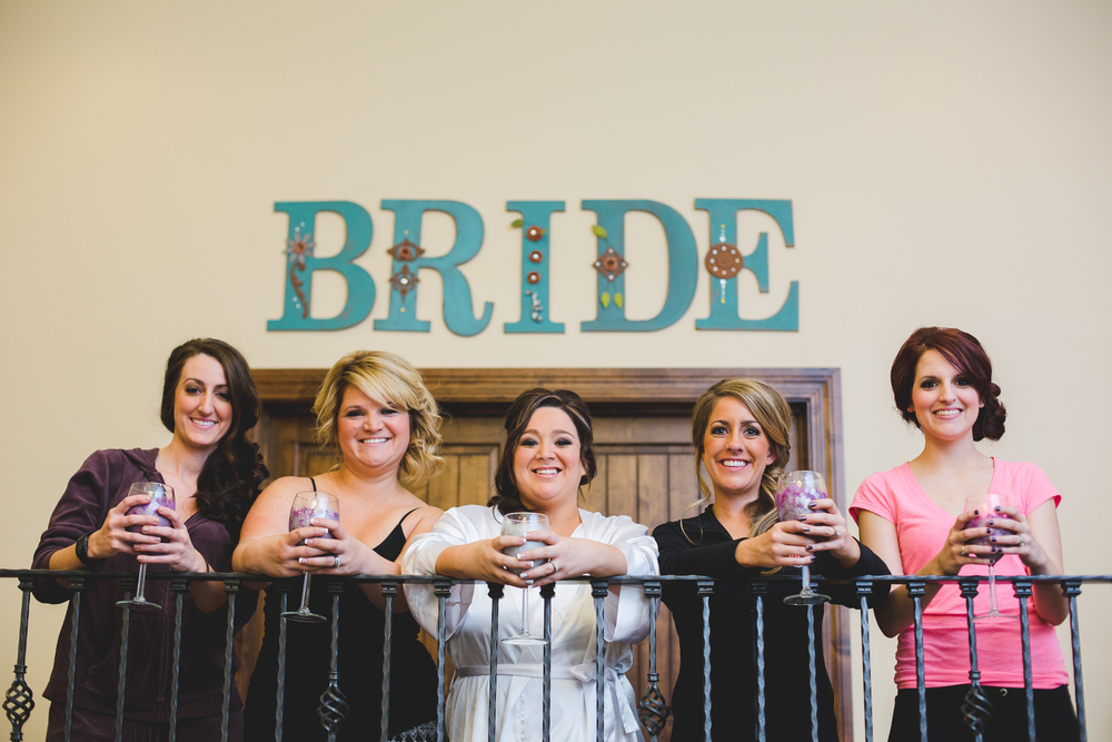 phoenix wedding photographer bride and bridesmaids having a getting ready toast
