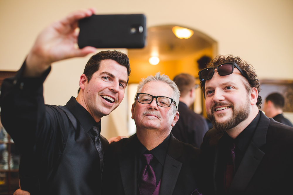 groom takes pic of him dad brother selfie style mj