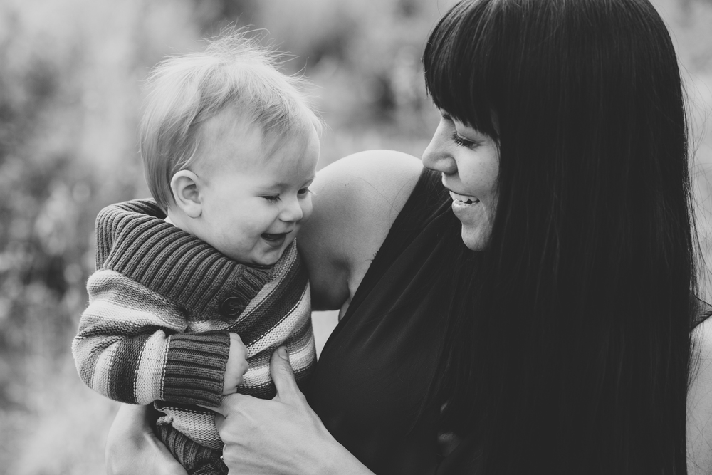 ball black and white mother son laughing photo