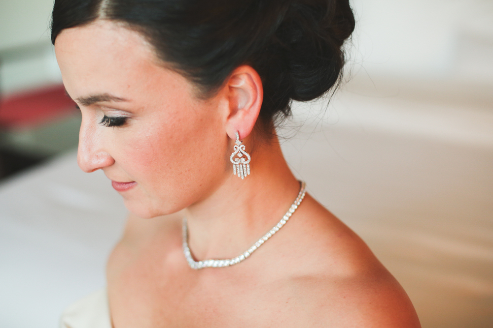 beautiful bride and her jewelry on and ready to go hj