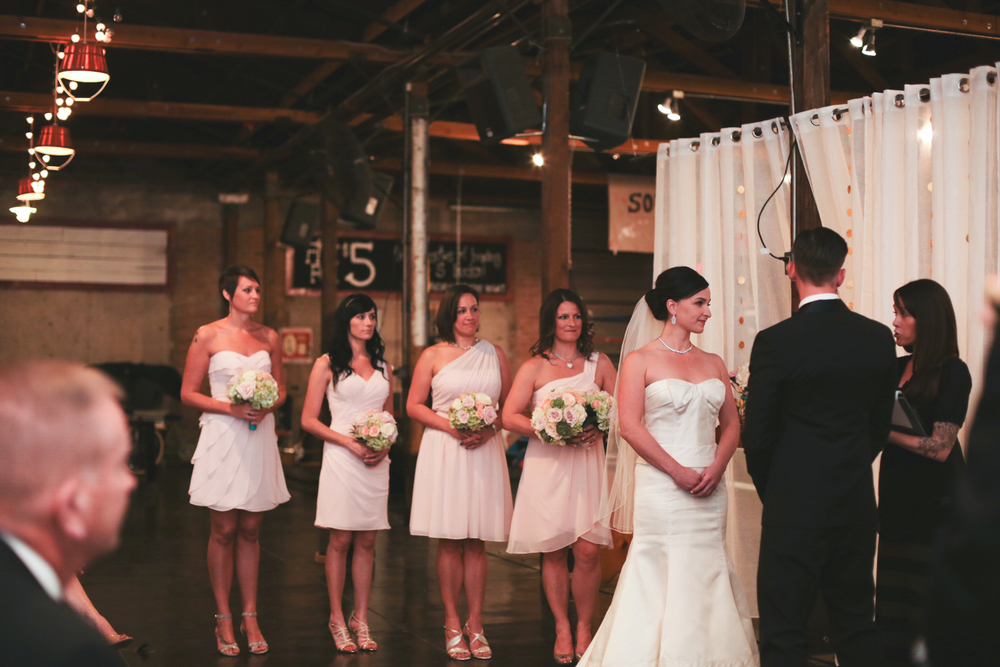 bride and bridesmaids at ceremony hj