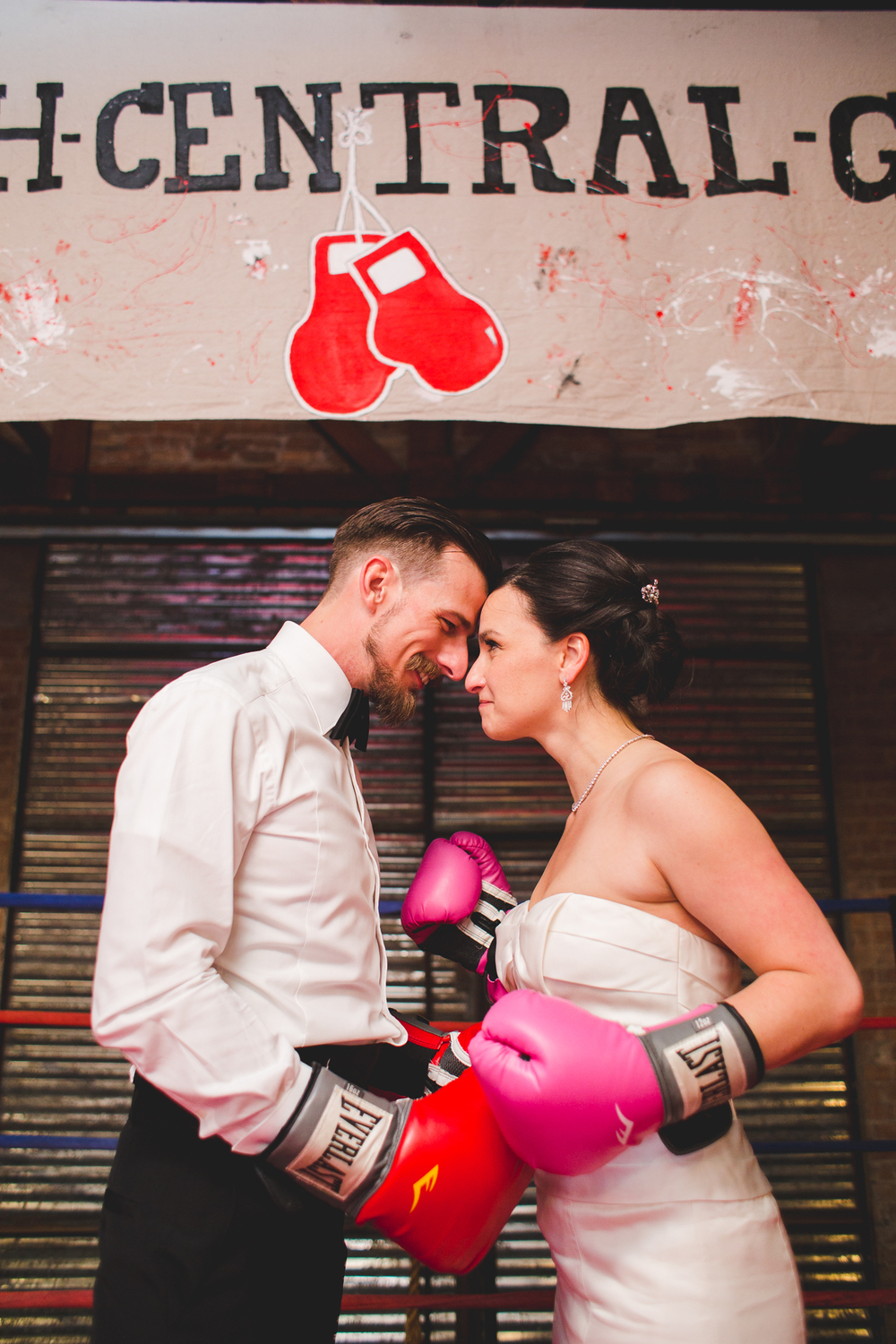 bride and groom in boxing ring with gloves on the duce hj