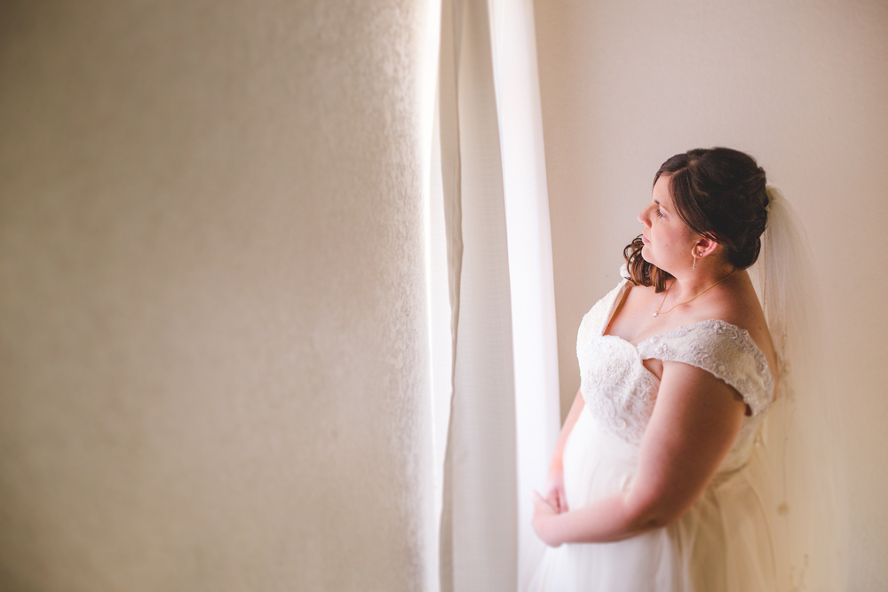 bride looking out window of house sd