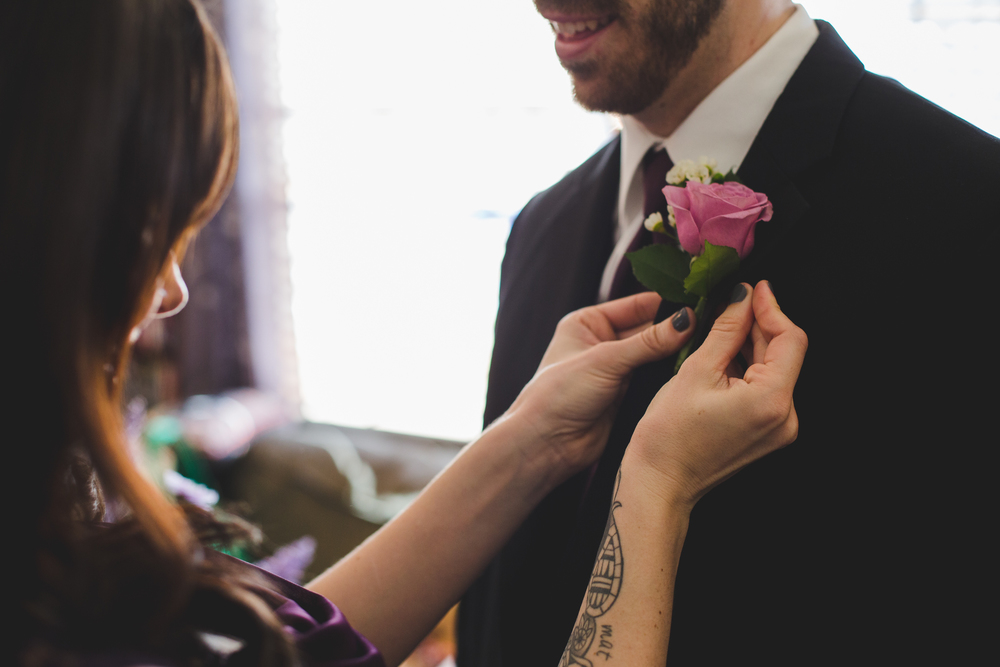 groomsmen gets his boutonniere sd