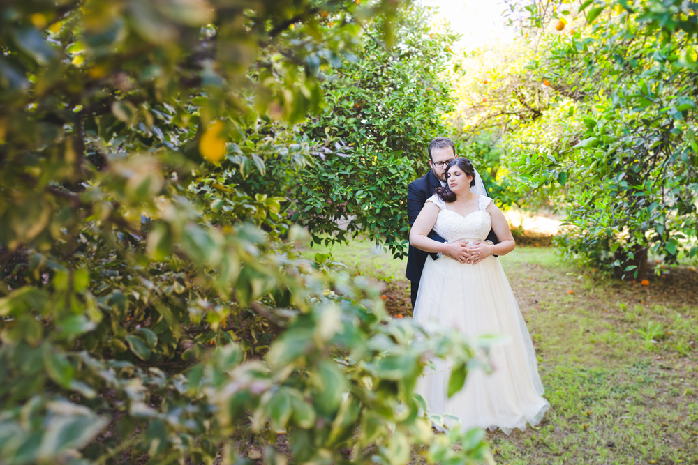 cool benizer method shot bride and groom hold each other in grove sd