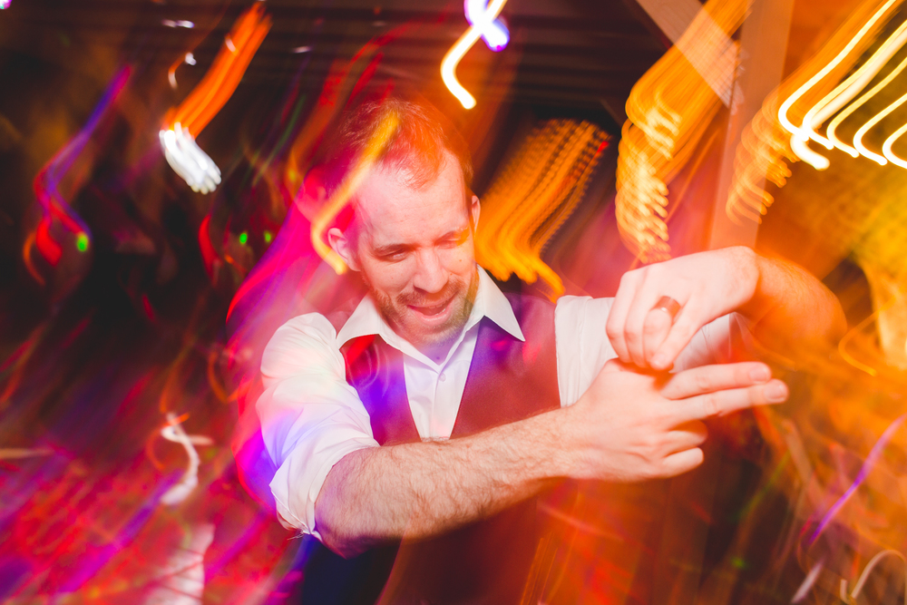 wedding attendee having tons of fun on dance floor finger guns sd