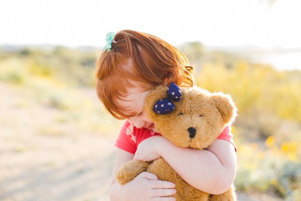 phoenix family photographer adorable girl hugging her teddy bear