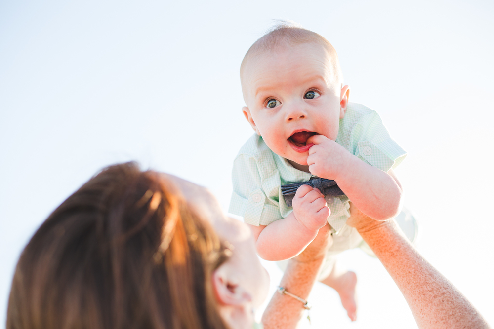aaron kes photography super cute baby held up by mom