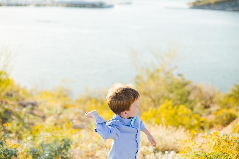 ethan throws rocks into the lake