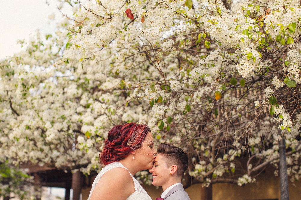 cute-romantic-kiss-wedding-portrait