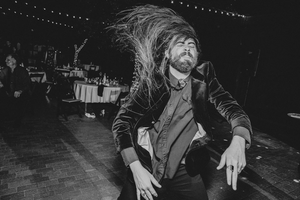 fun-dancing-wedding-photo-long-hair