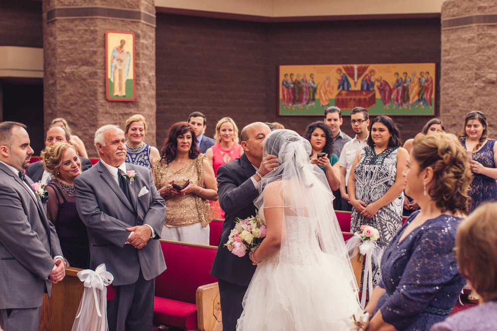 father-kissing-bride-wedding-ceremony