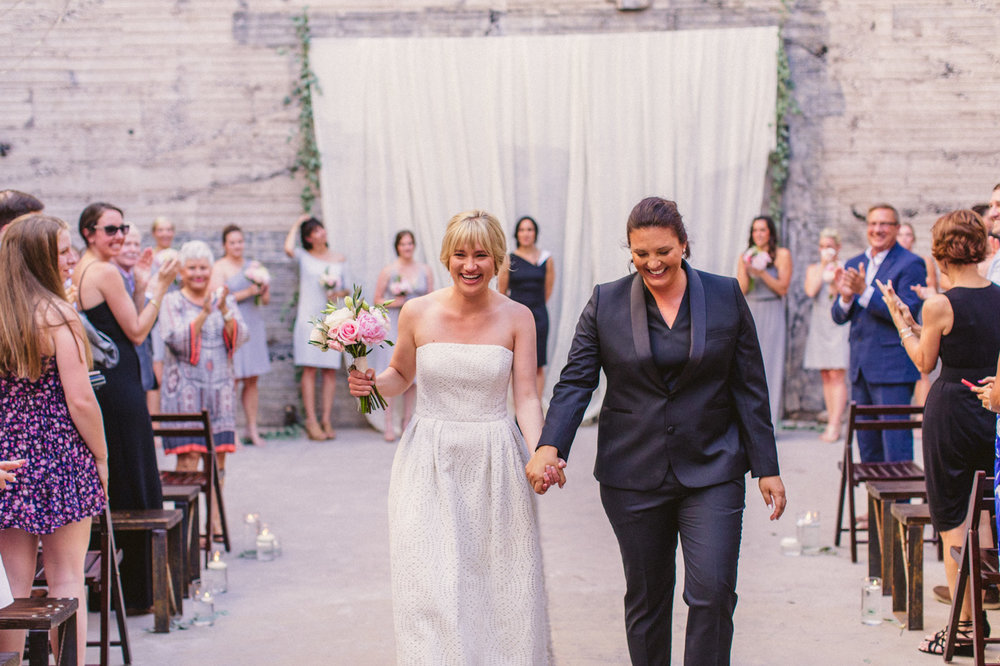 brides-leaving-wedding-ceremony
