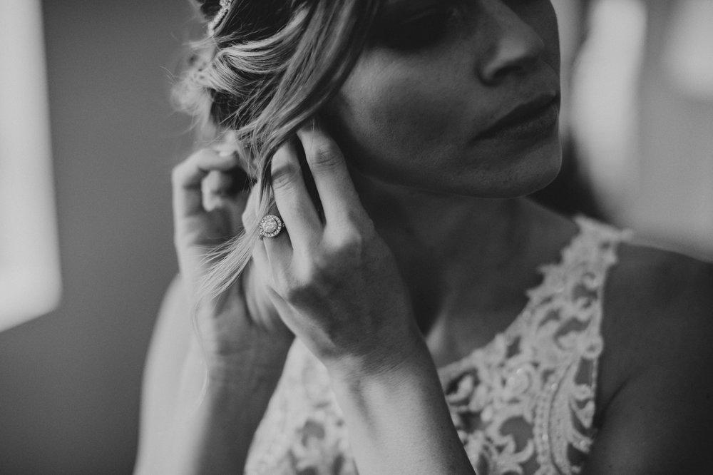 bride-putting-earrings-on