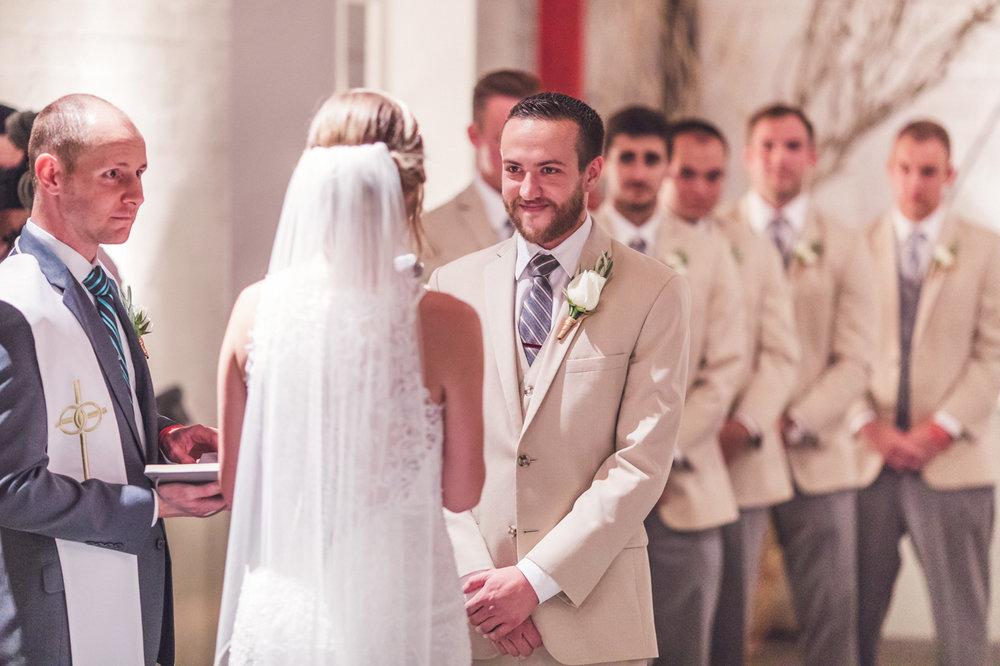 groom-smiling-at-bride-wedding-ceremony