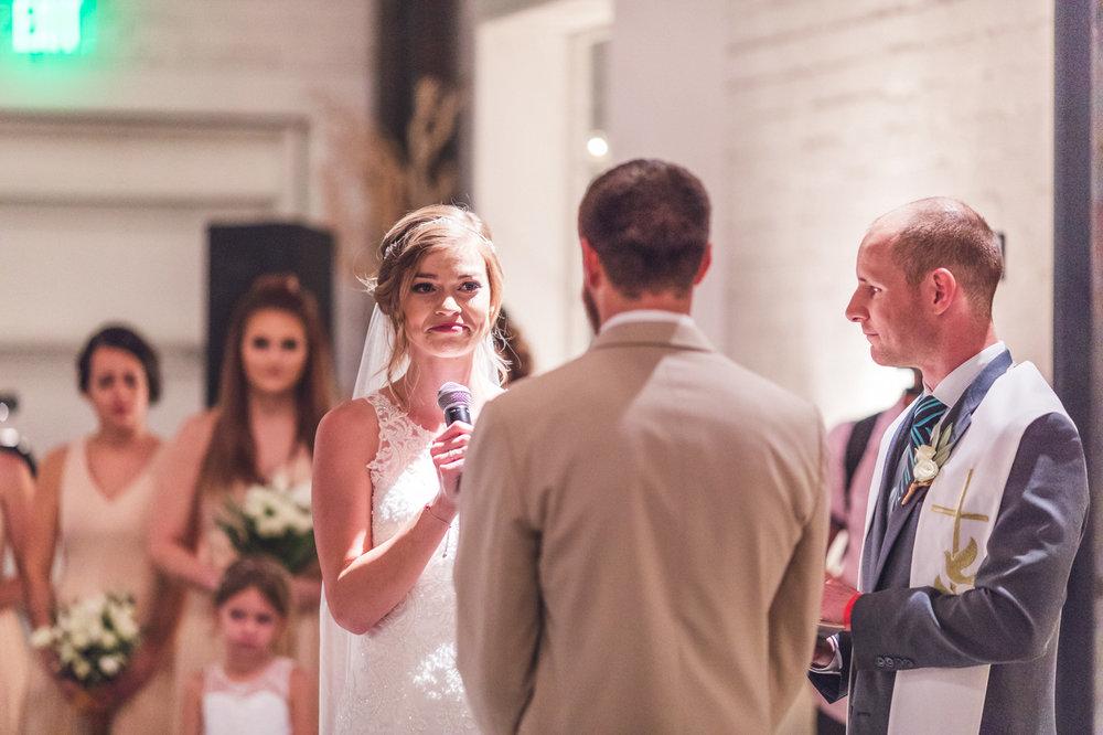 bride-tearing-up-wedding-ceremony