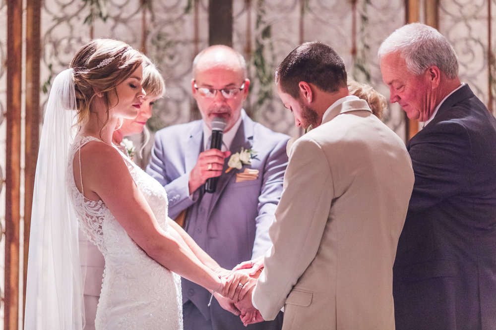 family-holding-hands-wedding-ceremony