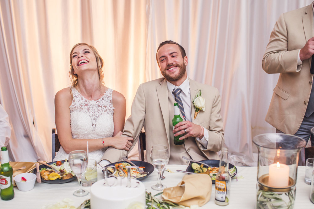 groom-laughing-wedding-reception