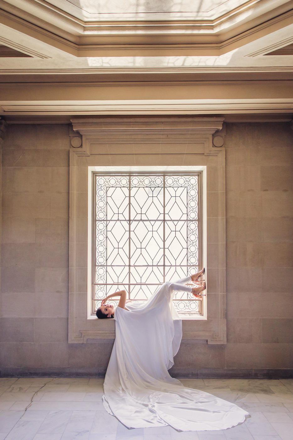 epic-cape-in-window-san-francisco-city-hall-wedding
