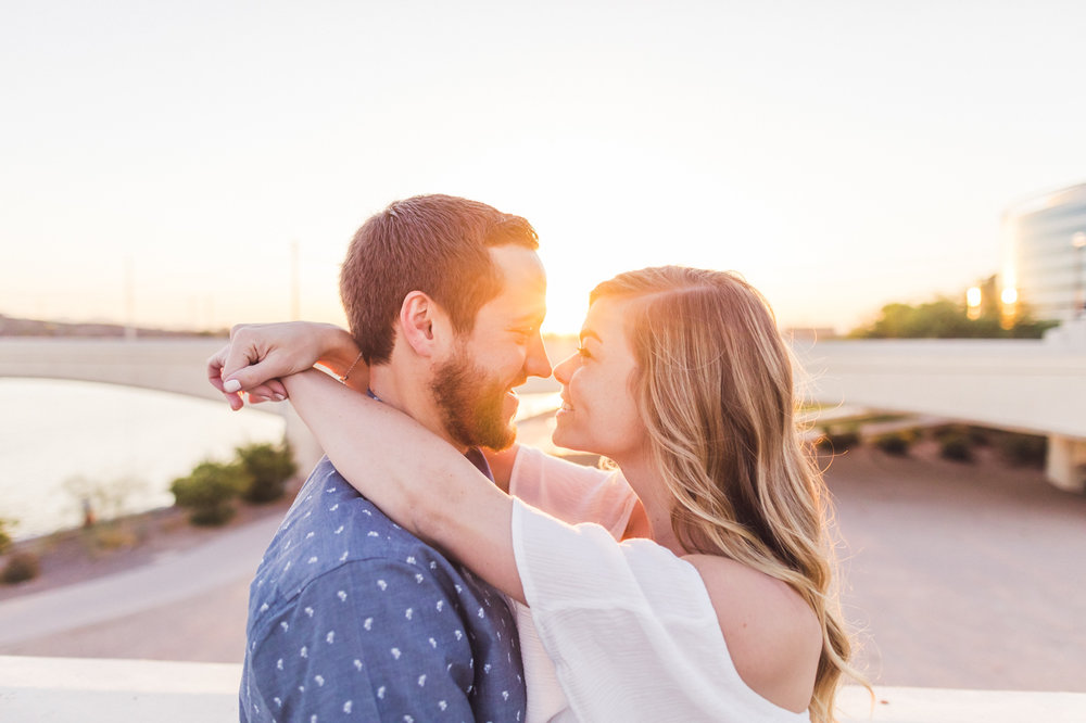 sun-flare-mill-avenue-bridge-engagement-session