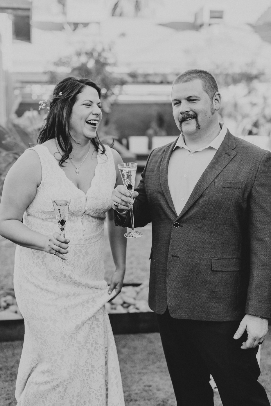 bride-groom-laughing-and-toasting