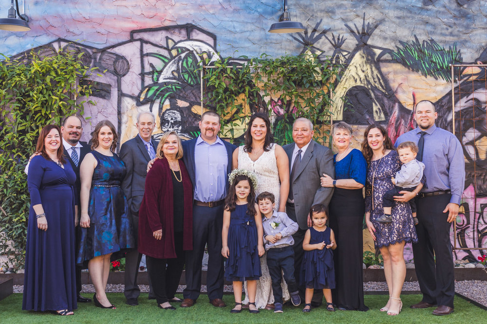 family-wedding-portrait-with-mural