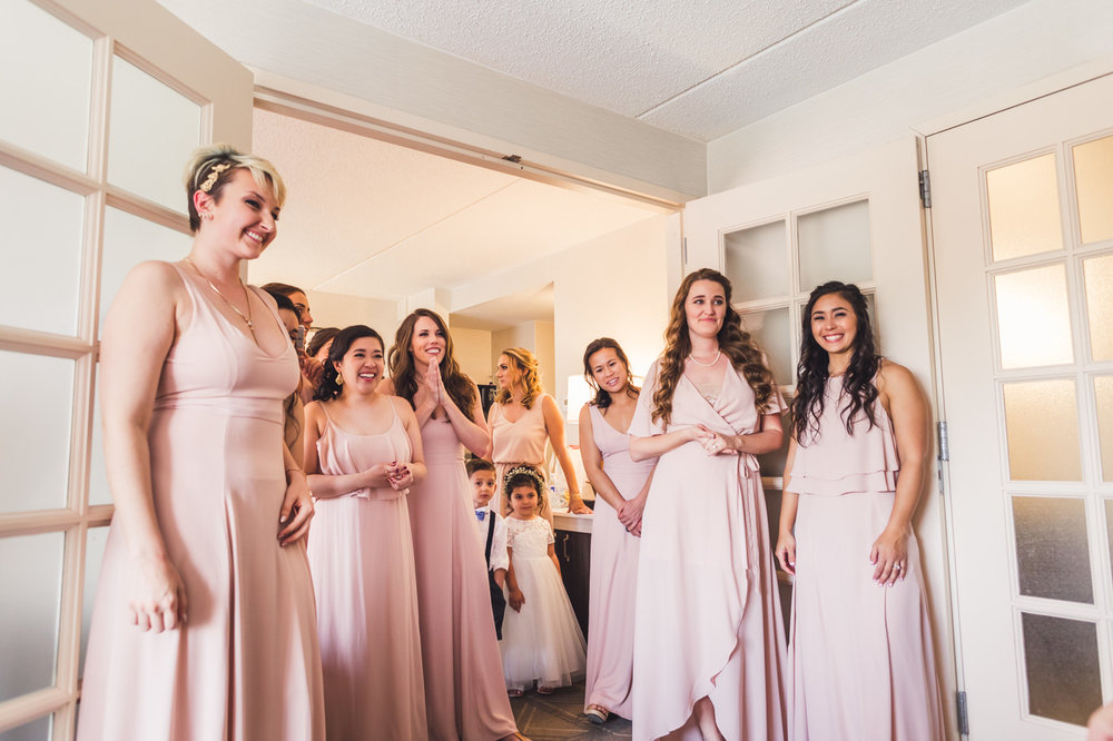 bridesmaids-look-at-bride