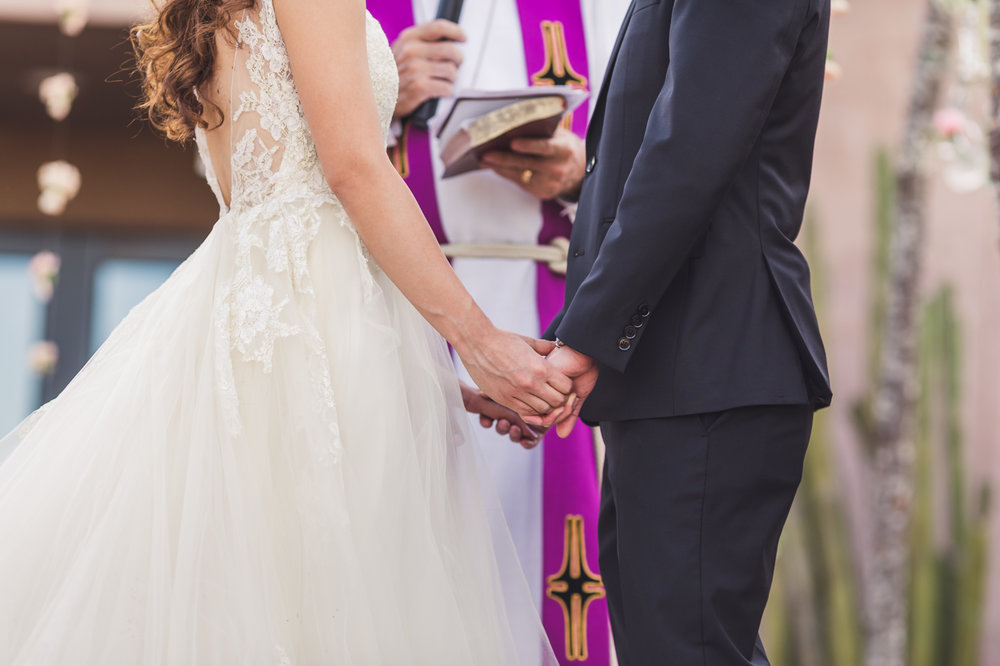 holding-hands-at-wedding-ceremony