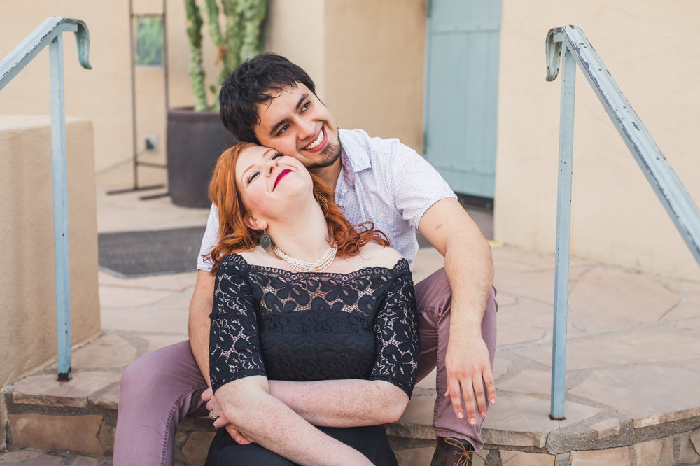 couple-cuddling-for-engagement-photo