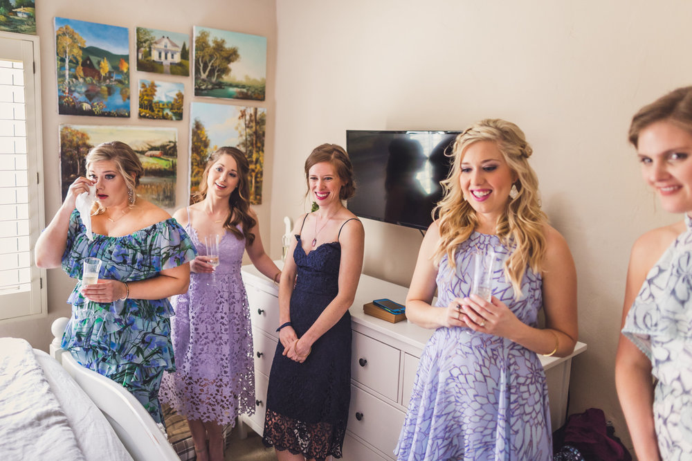 bridesmaids-seeing-bride-in-dress