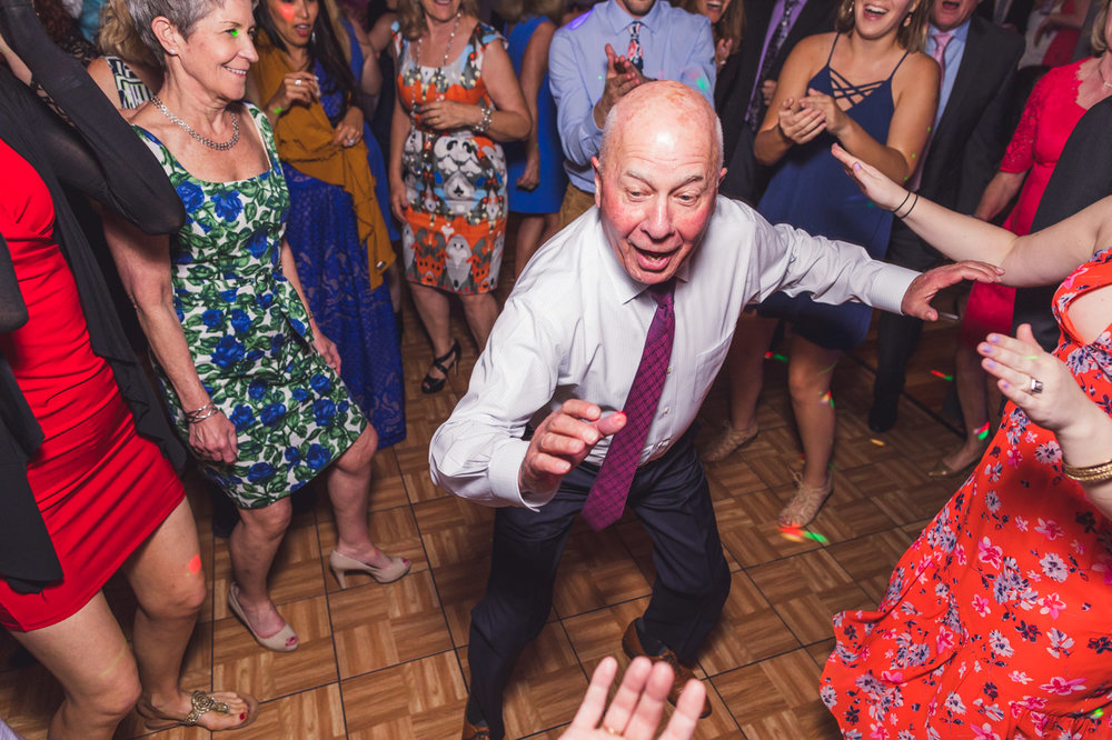 older-wedding-guest-having-fun-dancing