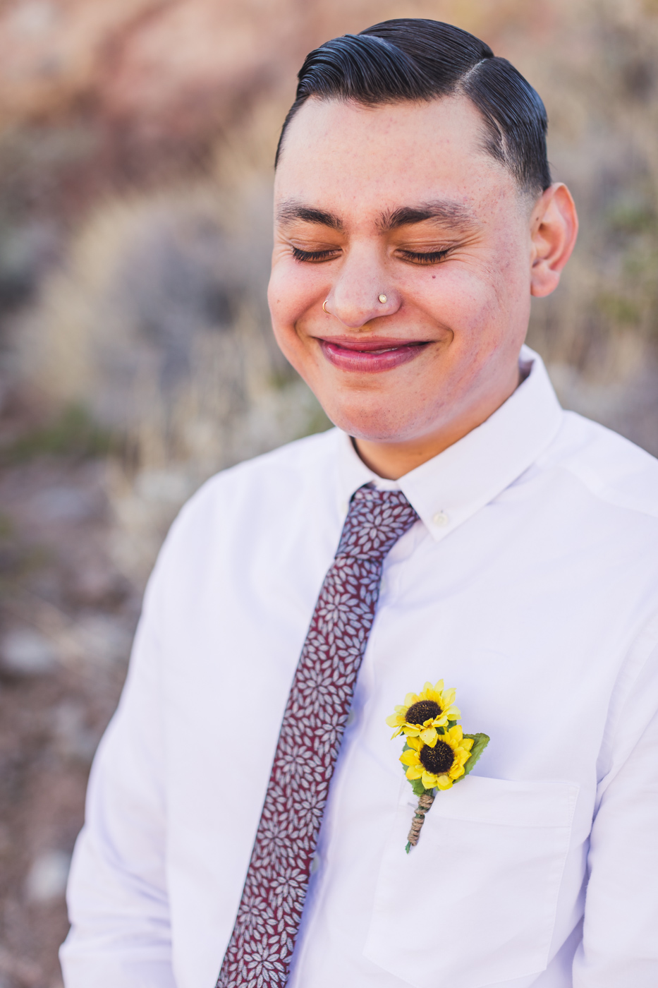 groom-smiling-at-wedding