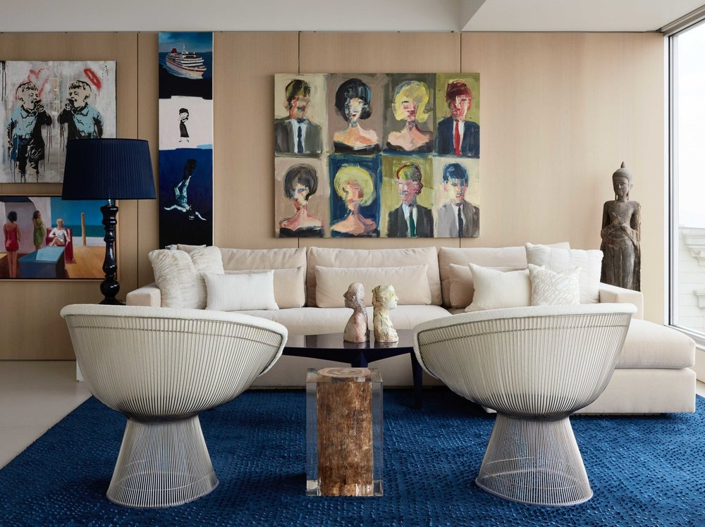 "In the living room of this Russian hill home, artist Marshall Crossman's ""Class Photo"" painting takes center stage. Boucle-upholstered Platner chairs flank a wood-and-acrylic table by Michael Dawkins."