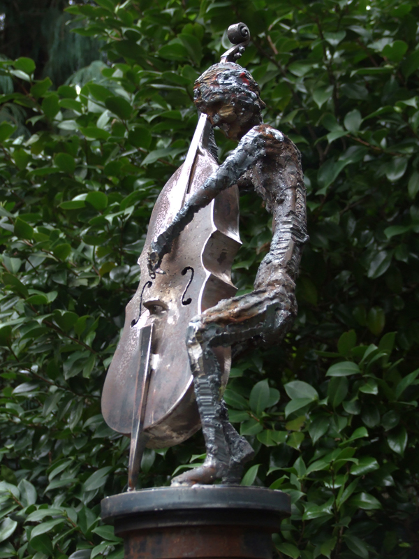 Cellist on gate