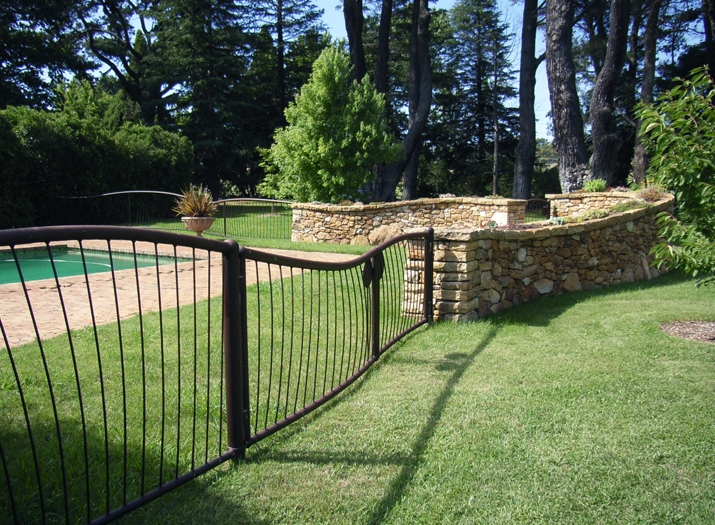 Pool fence and wall.