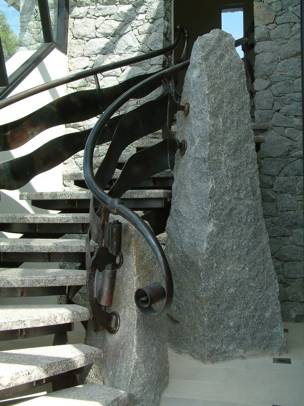 Staircase, steel and granite.