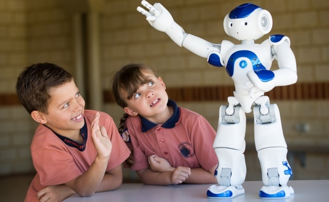 Waikiki Primary students Ziggy Williams and Kaysia Stalenhoef with their NAO robot named 'Neo'. Pictures: Mogens Johansen/The West Australian