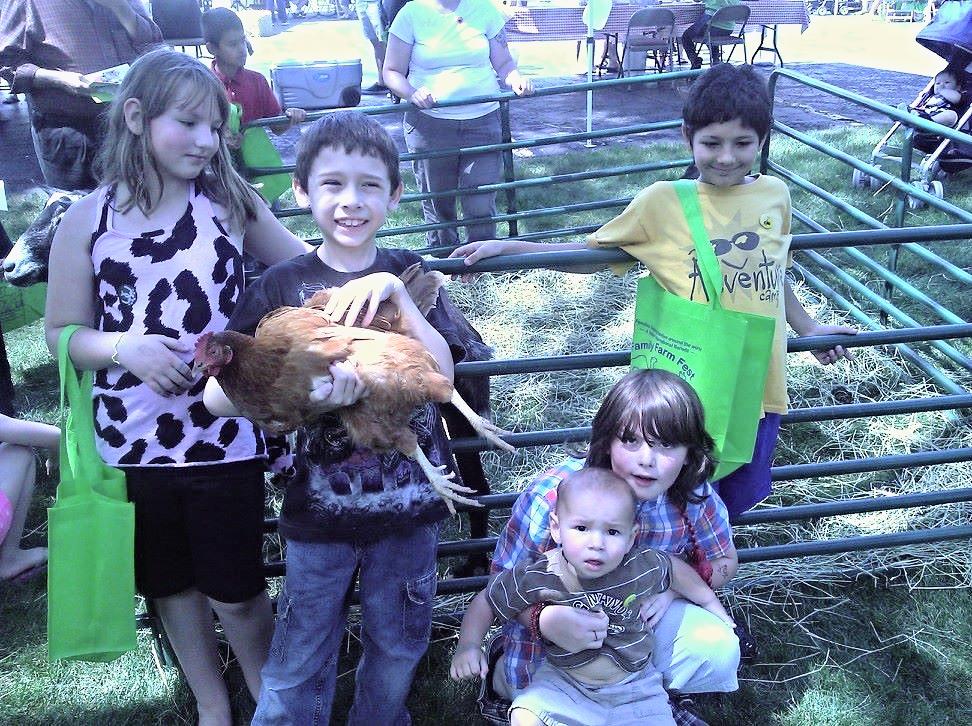 photo taken at Family Farm Fest 2013, AnchorKids donation of animals to Heifer International