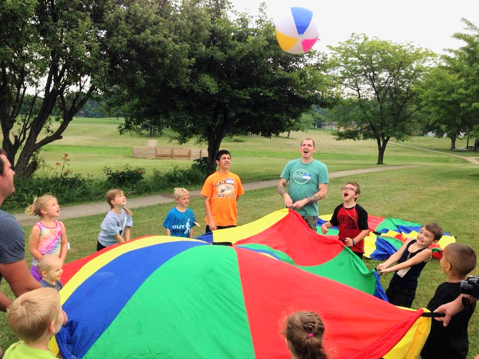 The Anchor pastor Sam Barnhart and volunteers playing with kids at Kids Camp at Camp LRCA in Crown Point, Indiana