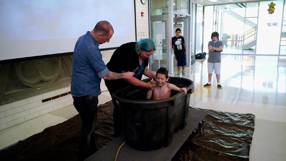 Val baptizing Josh