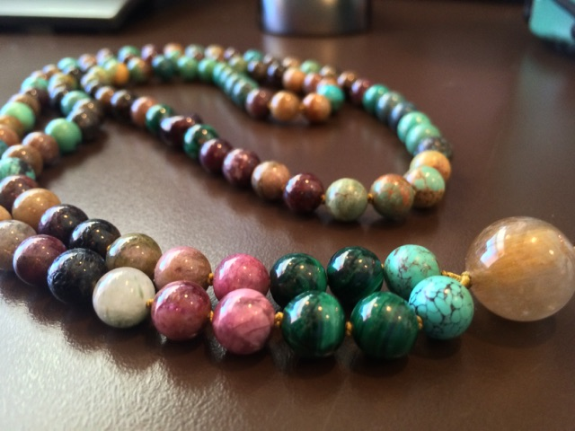 The Tiger Mala for Boulder Yoga Teacher, Megan Powell. Chinese turquoise, Malachite, and 7 cuts of Tourmaline with Rutile Quartz as Guru.