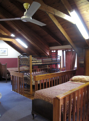 Upstairs in Olympic Cottage. You will be sleeping in the beds of Olympic Champions. Dormitory room.