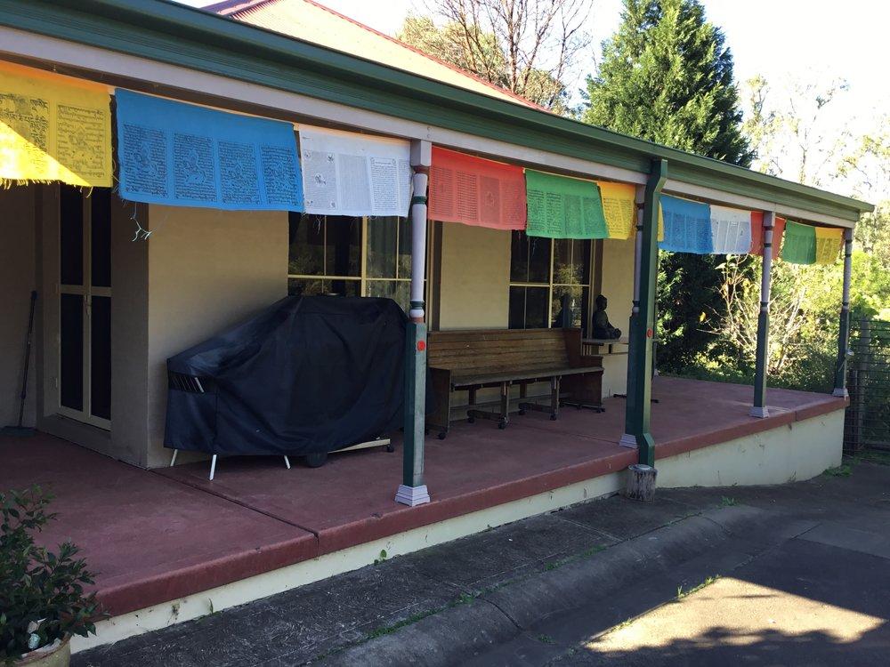 Tibetian prayer flags decorate the verandah of Winna Guest House