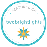 Two Bright Lights Badge.png