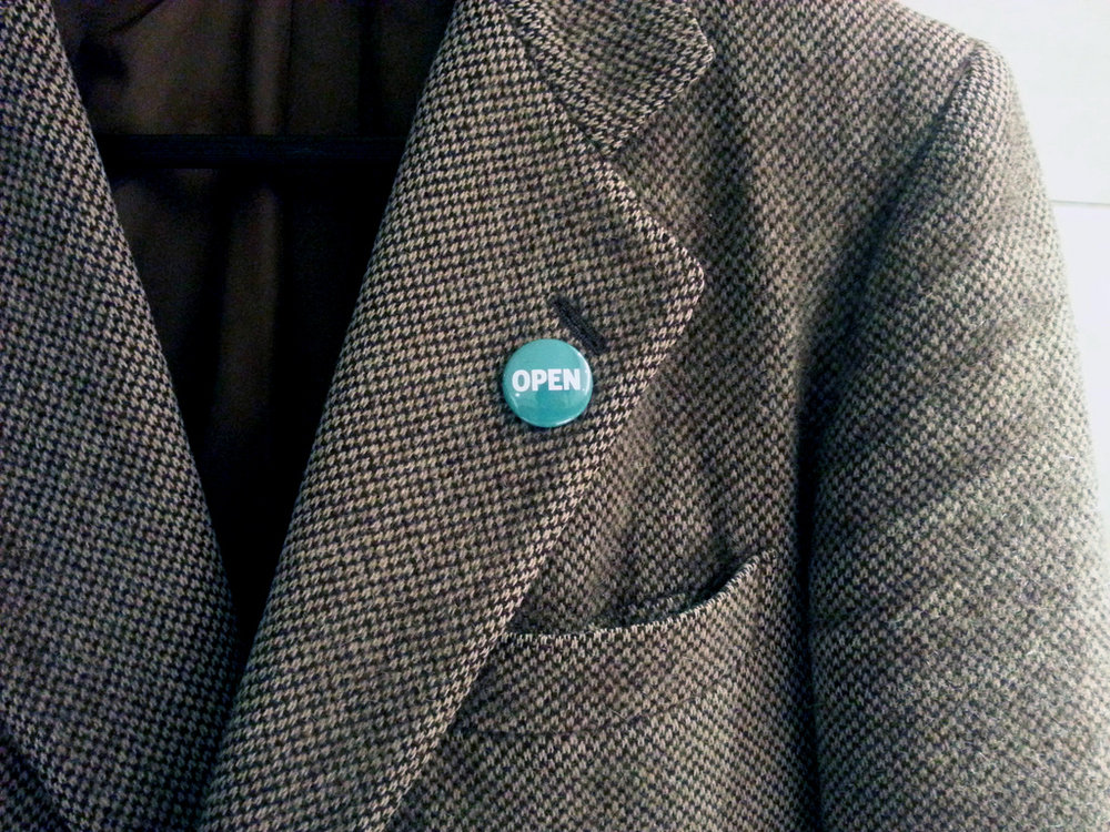 """Open Knowledge Foundation, """"OPEN"""" lapel pin, by  Brian Glanz"""