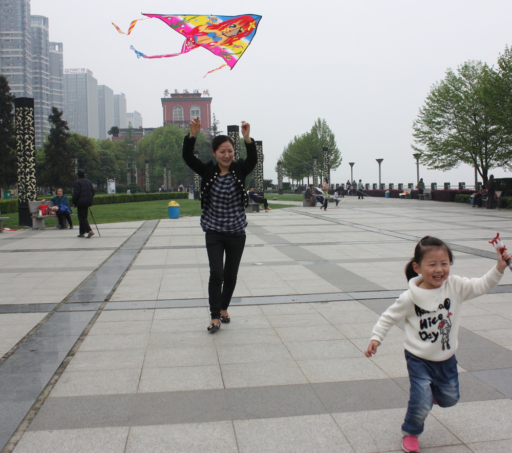 Girl and mother fly a kite